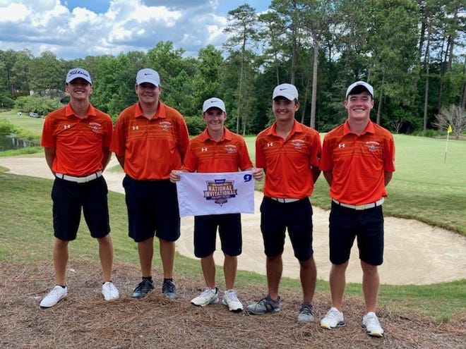 Members of the Macomb boys golf program pose at the end of their tournament at Pinehurst National on Thursday.