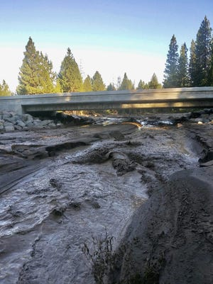 Mud, boulders and other debris came crashing down Mud Creek near McCloud on Sunday.