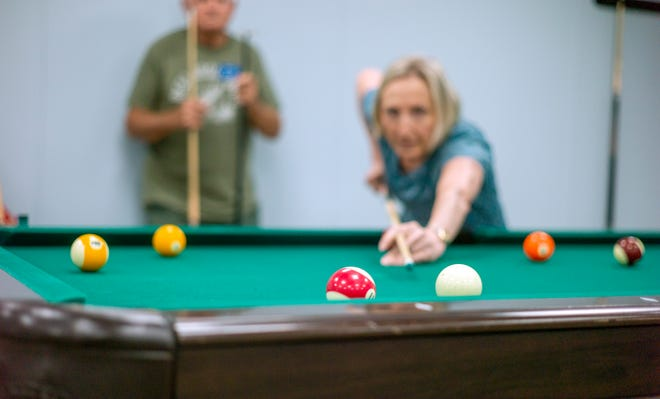 The billiards/table tennis room at the Niceville Senior Center is busy with a friendly round of pool.