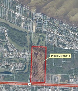 This aerial photograph shows the 25-acre site in Miramar Beach proposed for a mixed-use development comprising 321 apartments along with commercial space. The project gets its first local government review on Wednesday.
