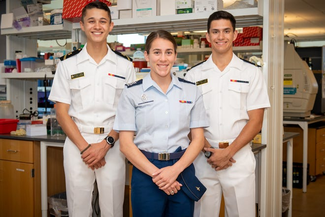 Oklahoma Medical Research Foundation 2021 John H. Saxon Service Academy Summer Research Program. From left, U.S. Naval Academy Midshipman Second Class Stephen Scholl, Air Force Academy squadron commander Erika Willis, and U.S. Naval Academy Midshipman Second Class Andrew Nixon.