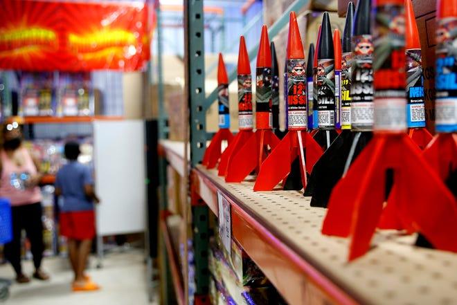 People shop for fireworks inside Fireworks Outlet OKC in Valley Brook, Thursday, July 1, 2021.