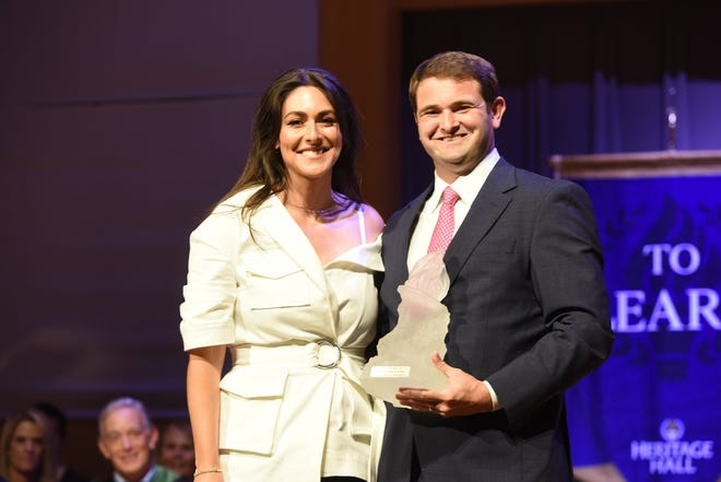 Sam McCurdy, Heritage Hall Alumni Association president-elect, right, presents the Heritage Hall Distinguished Alumni Award to Erielle Reshef.