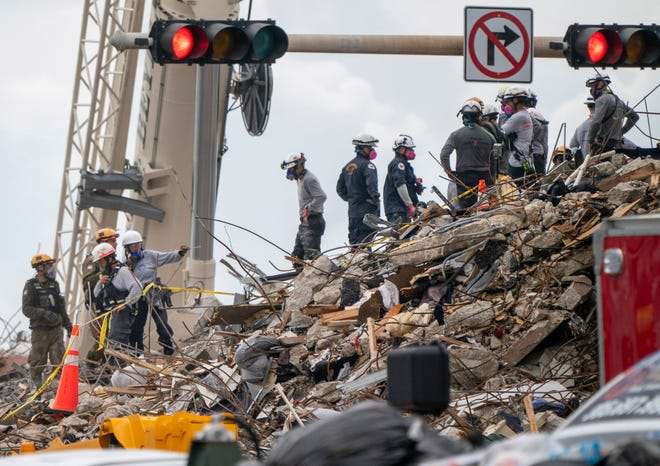 Search and Rescue teams look for survivors and those who died in the partially collapsed 12-story Champlain Towers South condo building.