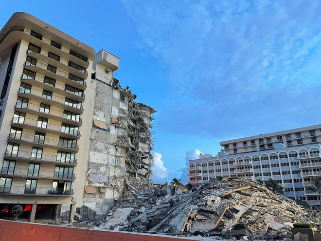 The 12-story Champlain South Tower building partially collapsed early June 24.