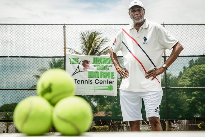 """James Marion stands on the Gaines Park's tennis courts in West Palm Beach that are named after Jimmie Horace """"Doc"""" Horne Sr. Horne, who passed away in 2008, will be inducted into the Black Tennis Hall of Fame on Friday. Marion, who was Horne's assistant coach for over 20 years, said Horne has """"done a lot for this community."""""""