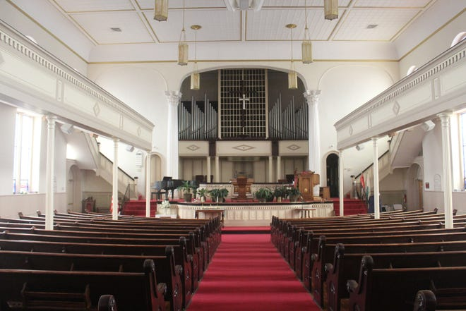The sanctuary within Gillfield Baptist Church can seat up to 1,600 people.