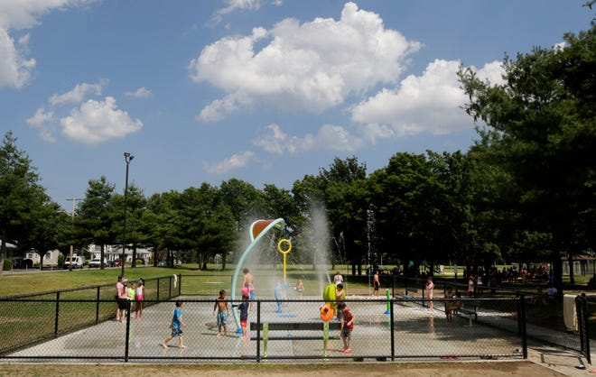 Kids cool off during a June heat wave at the waterpark at Pierce Memorial Field in East Providence.