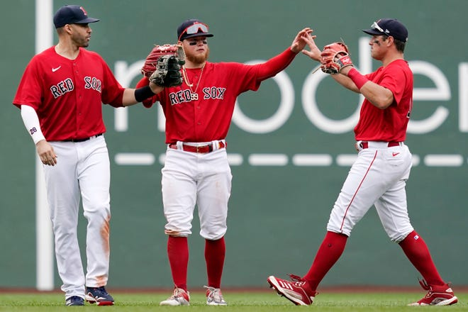 Boston Red Sox outfielders, from left, J.D. Martinez, Alex Verdugo, and Hunter Renfroe celebrate after defeating the Kansas City Royals in a baseball game at Fenway Park, Thursday, July 1, 2021, in Boston. (AP Photo/Elise Amendola) ORG XMIT: MAEA118
