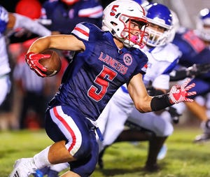 East Union's Alex Alexander (5) finds running room through the Bear Creek defense during the first half of a varsity game Aug. 31, 2018, between Bear Creek and East Union at Dino Cunial Field in Manteca.