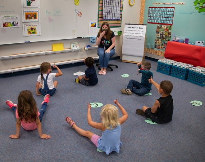 Kids in Transition to School program lead Sarah Melton teaches school rules during the first week of classes at Prairie Mountain School in Eugene.