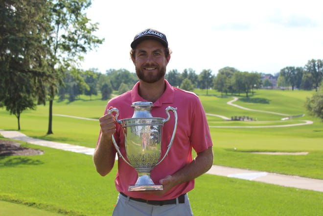 Jake McBride holds the trophy after winning the 100th Ohio Open Championship at Westfield Country Club on Thursday, July 1.