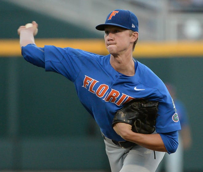 Kansas City Royals pitcher Brady Singer (51) helped Florida win its only baseball national championship in the 2017 College World Series.
