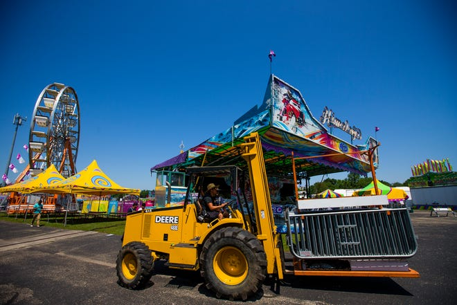 Crews move railings Thursday at the St. Joseph County 4-H Fairgrounds in South Bend in preparation for the fair opening July 2.