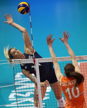 Penn High School grad Annie Drews, shown here in 2019 with Team USA Volleyball, will play in the Olympics this month.