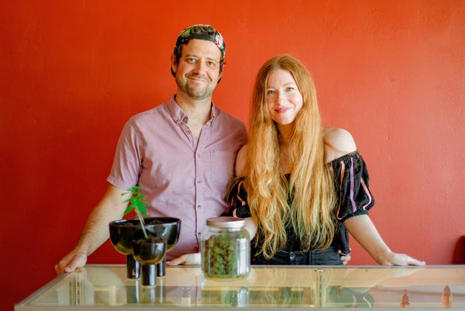 Max Gaudin and Laura White, owners of Soul Addict, stand at the counter of their new retail store in Vale.
