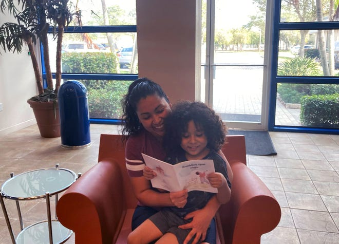HIPPY participants Maria Orozco and her son, Dylan Mendoza, enjoy reading a book together.