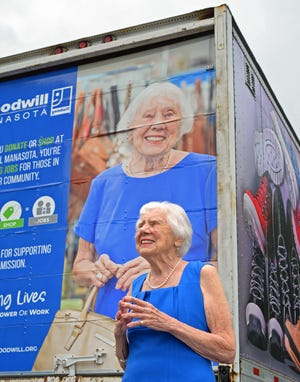 Jo Rita Stevens, 89, has donated her time and resources to the Goodwill organizations for the last 54 years. Here Stevens, 89, stands by the Goodwill semi truck with her photograph on the back of it.