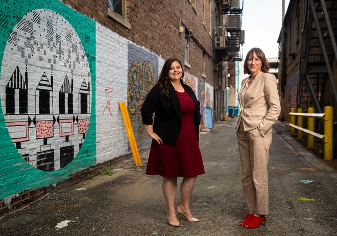 Downtown Springfield Inc.'s Art Alley is a project that both Kayla Graven, left, and Lisa Clemmons Stott, right, are proud of accomplishing as a beautification project for the downtown area. Kayla Graven will take over as executive director of DSI as Lisa Clemmons Stott steps down after five years at the helm. [Justin L. Fowler/The State Journal-Register]