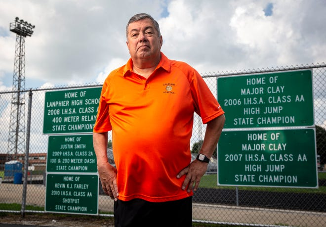 Lanphier High School's Mike Garcia is retiring as the boys cross country and track and field coach after 30 years of helping lead high school athletes to multiple state championships. [Justin L. Fowler/The State Journal-Register]