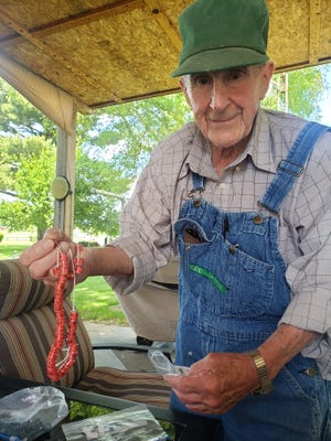 """William """"Bill"""" Lamb displays the bands that are used to identify his pigeons during a race. Lamb, who has been interested in pigeon racing since he was a young boy, is one of 12 members of the Kewanee Invitational Club."""