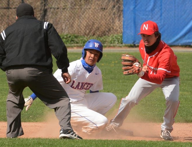 NFA's Ty Pomroy looks for the out against Waterford baserunners Ryan Salvador during a game last spring. Pomroy is part of Norwich's American Legion baseball resurgence this summer.