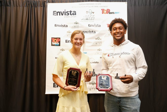 The most outstanding athlete award winners, Desmond Purnell and Ellington Hogle, pose for a photo at Wednesday's Shawnee County Sports ceremony at the Capitol Plaza Hotel.