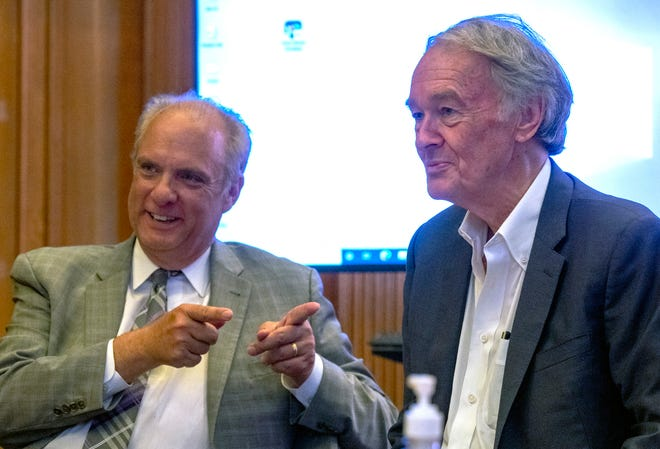 Mayor Joseph M. Petty, left, mentions U.S. Sen. Ed Markey while speaking at a meeting of the Municipal Broadband Committee Thursday at City Hall.