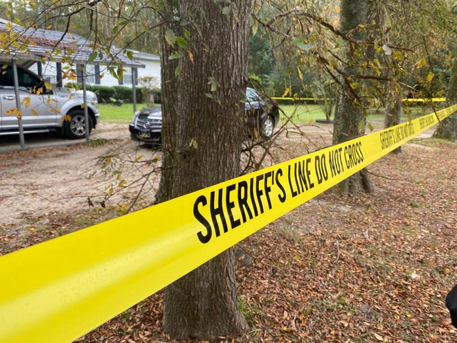 Crime scene tape surrounds a home on Bandore Circle where a man was shot to death Nov. 9, 2020, after a knock at his door. An arrest was made in the case Wednesday.