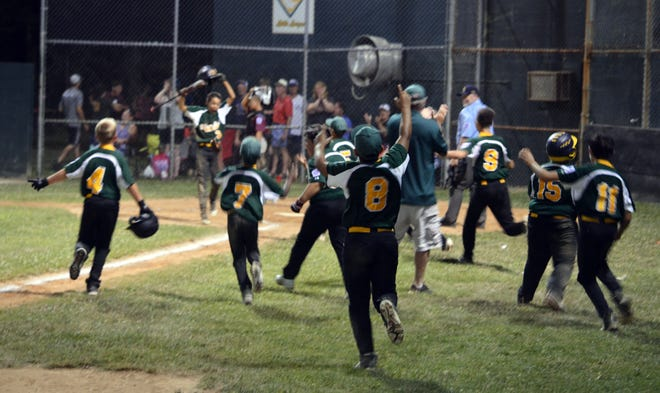 West End players erupt onto the field to celebrate their 6-5 win over Maugansville in the Maryland District 1 9-11 championship game Wednesday night.