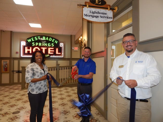 The ribbon was cut to open Lighthouse Mortgage Services in the Homestead building in West Baden Springs on June 28. Pictured are, left to right, Alexis Lee from the French Lick - West Baden Chamber of Commerce, Loan Officer Andrew Toliver and Branch Manager Rick Ferguson II.