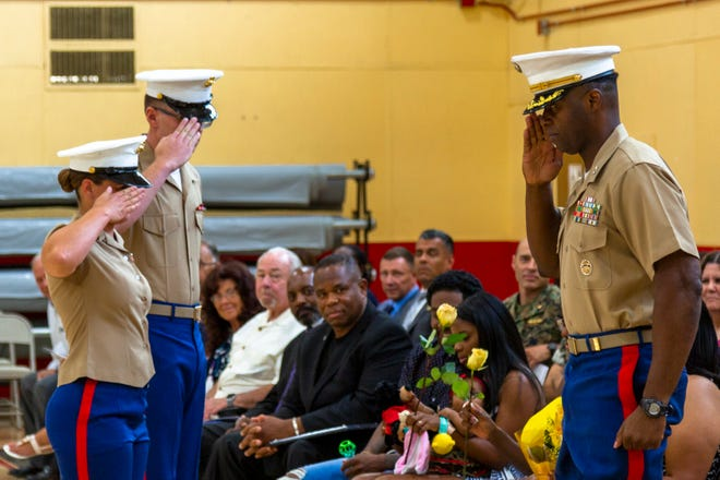 Col. Gregory B. Pace (right) is inaugurated as the new commander of the U.S. Marine Corps Logistics Base in Barstow on Thursday, July 1, 2021.