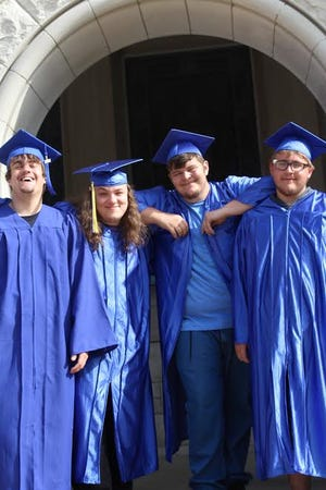 (L-R) Camden Boltenhouse, Nathaniel Scurlock, Travis Starr, Lee Williams, and Dylan Atwood and Donovan Carango, not pictured, received a high school diploma and multiple National Center for Construction Education and Research (NCCER) certifications, CPR certifications, and OSHA certifications after graduating from the YouthBuild program.