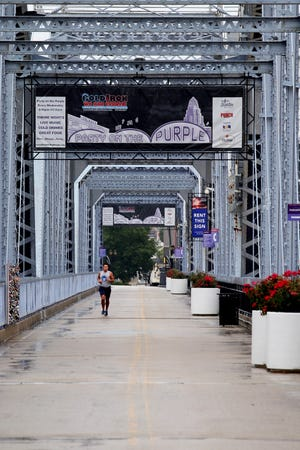 Jake Oswald, of Newport, Kentucky, runs along the Purple People Bridge. Access to the bridge reopened on the Kentucky entrance July 1, but the Ohio entrance remains closed.