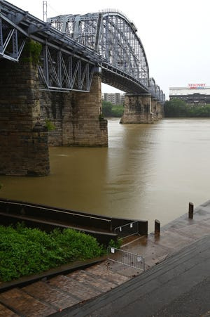 Entry points to the pier of the Ohio portion of the Purple People Bridge are shut off on Thursday, July 1, 2021 because of damage caused by flooding.