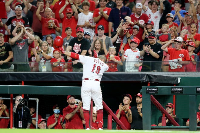 Joey Votto acknowledges an ovation from the crowd after his solo home run in the third inning to collect his 1,000th career RBI on Wednesday, June 30, 2021, at Great American Ball Park in Cincinnati.