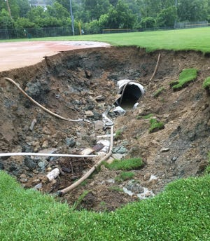 A drain pipe at McDonald Commons in Madeira failed, causing a 20-foot-by-40-foot sinkhole near baseball field B.