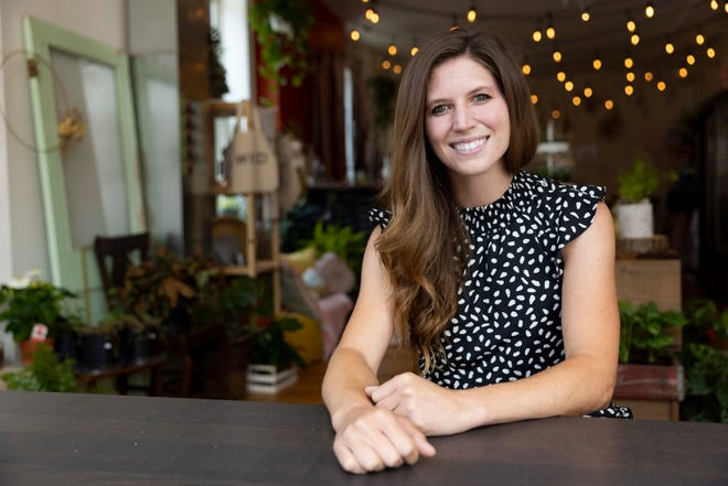 Megan Moore, the owner of Daisy Jane's Flower Truck, poses for a portrait at Daisy Jane's Flower Truck in Walnut Hills, Wednesday, June 30, 2021.  Daisy Jane's Flower Truck recently opened its brick-and-mortar store.