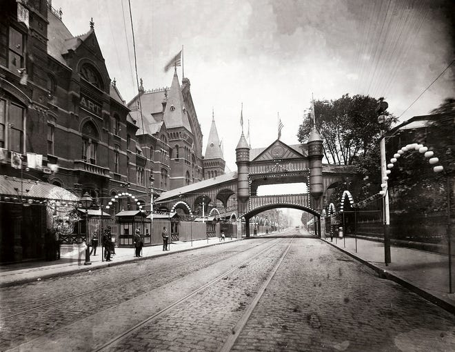 Music Hall was one of the exhibition buildings for the Centennial Exposition in Cincinnati in 1888. The temporary bridge over Elm Street connected Music Hall to the Washington Park Building.