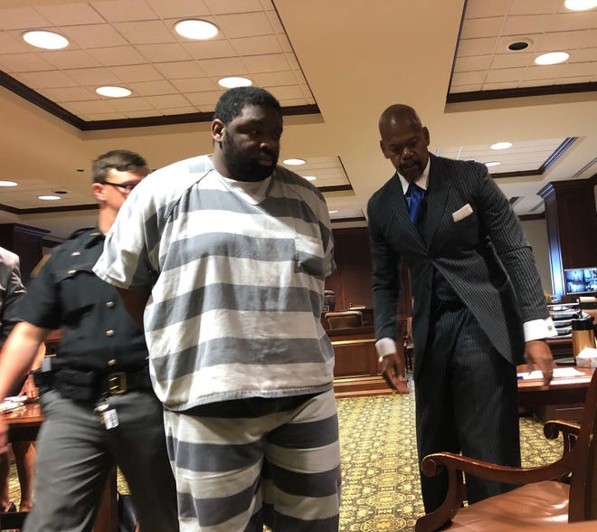 Durrell Nichols is led into Hamilton County Common Pleas Judge Alison Hatheway's courtroom on Thursday, July 1, 2021. His attorney, Clyde Bennett II, is at right.