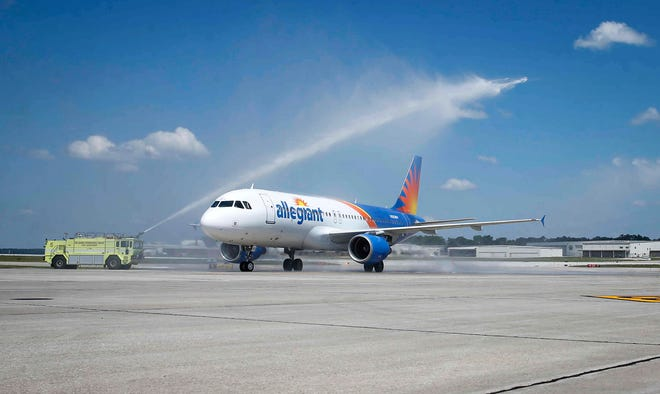 An Allegiant Air flight 2993 arrives in Des Moines from Houston to a water cannon welcome on Thursday, July 1, 2021, at the Des Moines International Airport. The airline company celebrated the announcement that Des Moines became the latest base, and the first since the COVID-19 pandemic.