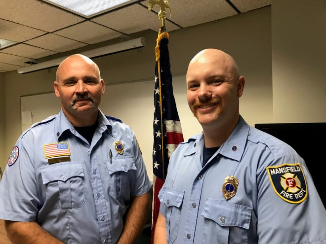 Robert Garn, left,  was promoted to captain at the Mansfield Fire Department and Todd Toussant was promoted to lieutenant Thursday at the Mansfield Fire Department, 140 ER. Third St.