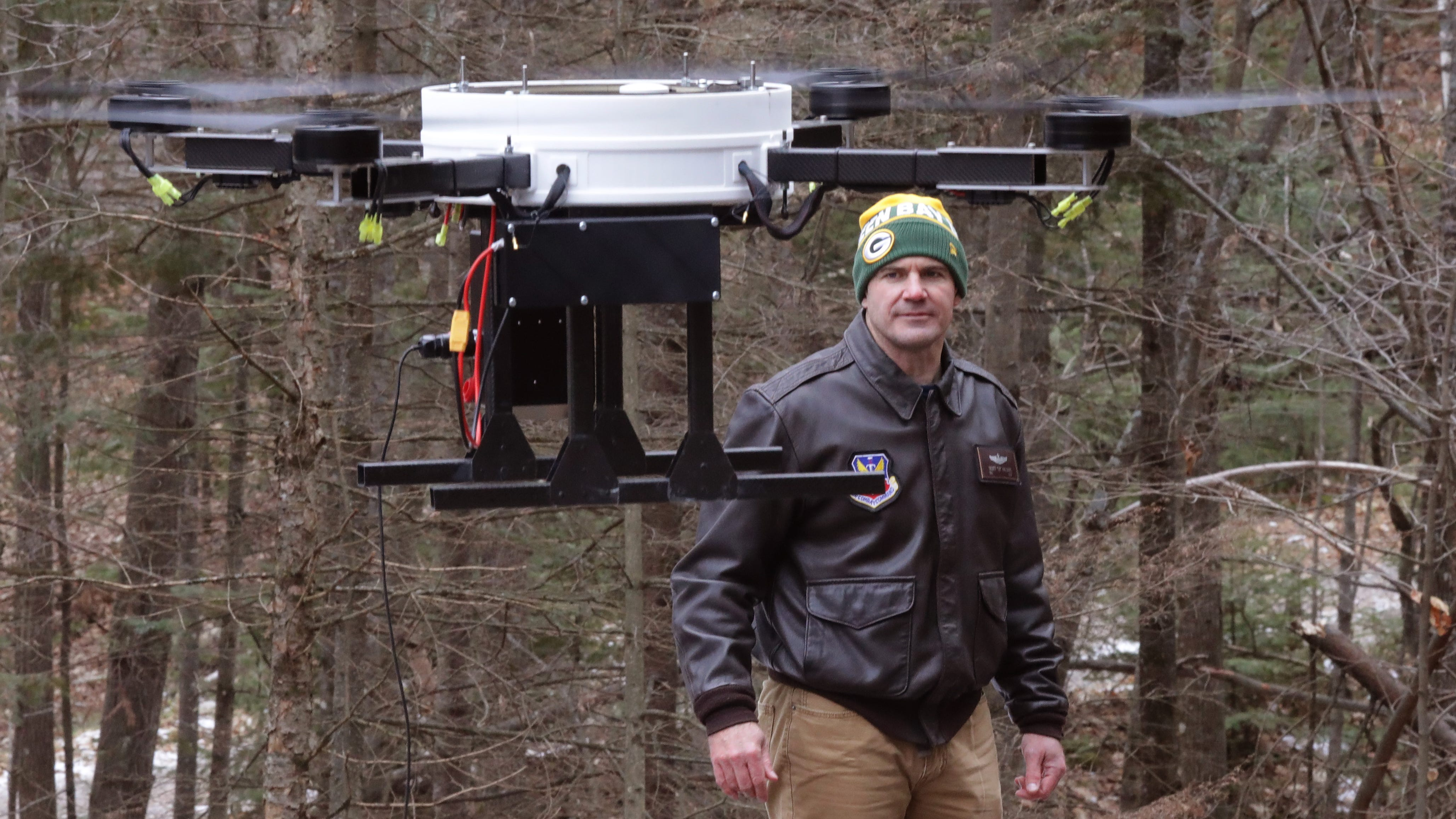 Scott Williams, founder of Wisconsin Telelift LLC, is shown with a prototype drone in Three Lakes. He plans to use it to hover over a rural area in the Northland Pines School District, with the drone sending a cellular signal to rural homes so students can work online.