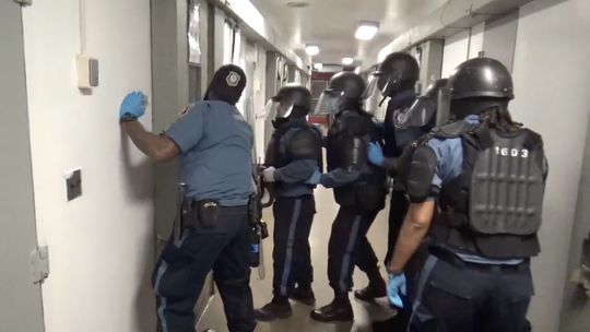 Corrections officers enter a cell inside New Jersey's Edna Mahan Correctional Facility for Women in a January 2021 incident that has led to criminal charges against 10 corrections staffers. Video screengrab.