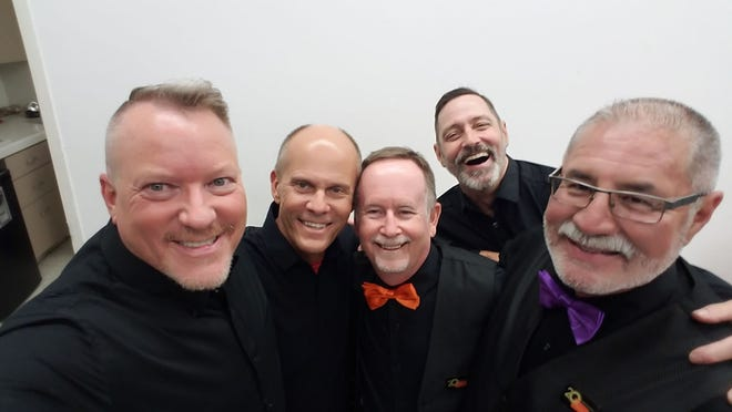 Steve Baker (center, red tie) poses with Palm Springs Gay Men's Chorus members Jeff Hocker, Tim Edmondson, Ted Fox and David Sanchez in 2019.