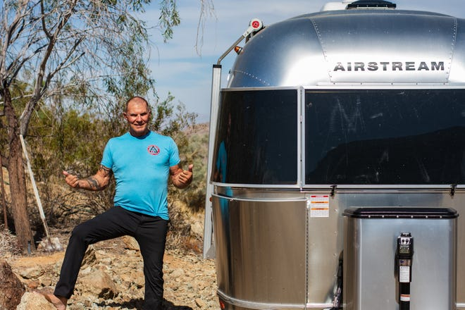 Glen Heggstad poses with his Airstream trailer on his property in Palm Desert, Calif., on June 8, 2021.