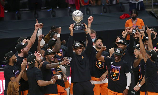 Phoenix Suns head coach Monty Williams hoists the Western Conference trophy after beating the LA Clippers in Game 6 at STAPLES Center on June 30, 2021.