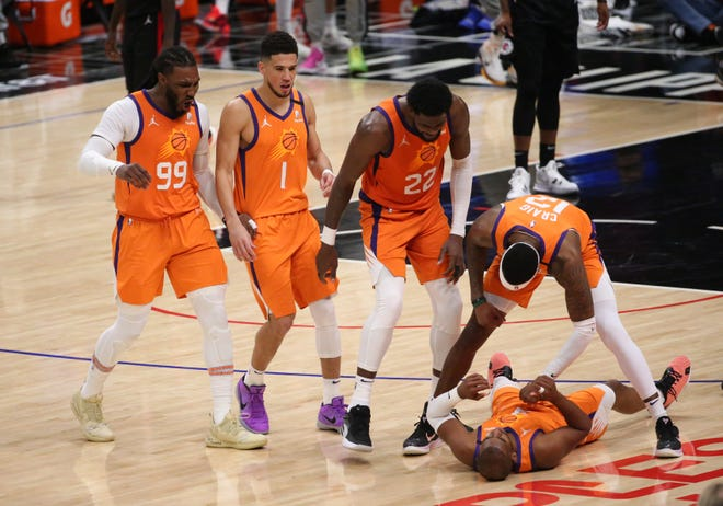Phoenix Suns guard Chris Paul (3) celebrates with his teammates after a foul on an LA Clippers basketball player during Game 6 at the STAPLES Center, June 30, 2021.