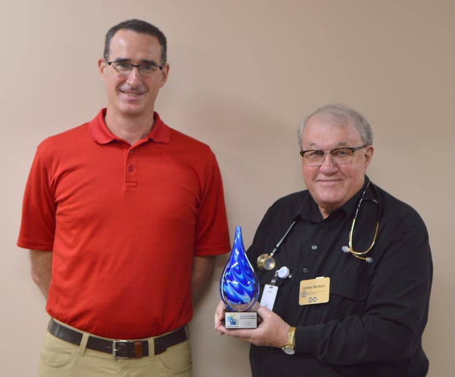 Jeff Hartz, Executive Director for the East Indiana Area Health Education Center (left), presented Dr. James Bertsch with the organization's Preceptor of the Year Award.