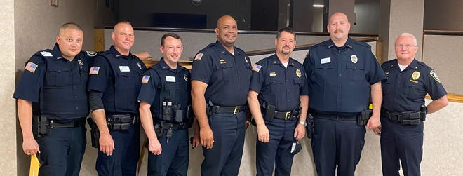 Reid Health Police Department's Officer Billy Terhaar (from left), Officer Scott Jackson, Officer Cory Jenkins, Capt. Dennis Perkins, Assistant Chief Jeff Cappa, Officer Scott Roberts, and Chief of Police Randy Kolentus at the Indiana Law Enforcement Academy graduation ceremony on Tuesday, June 29, 2021.